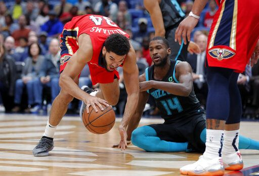 970887b8c5b New Orleans Pelicans guard Kenrich Williams (34) battles for a loose ball  against Charlotte