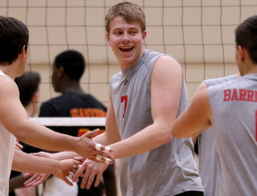 Barrington's Ben Ridgway celebrates a point with others during varsity boys volleyball in Schaumburg on Thursday.