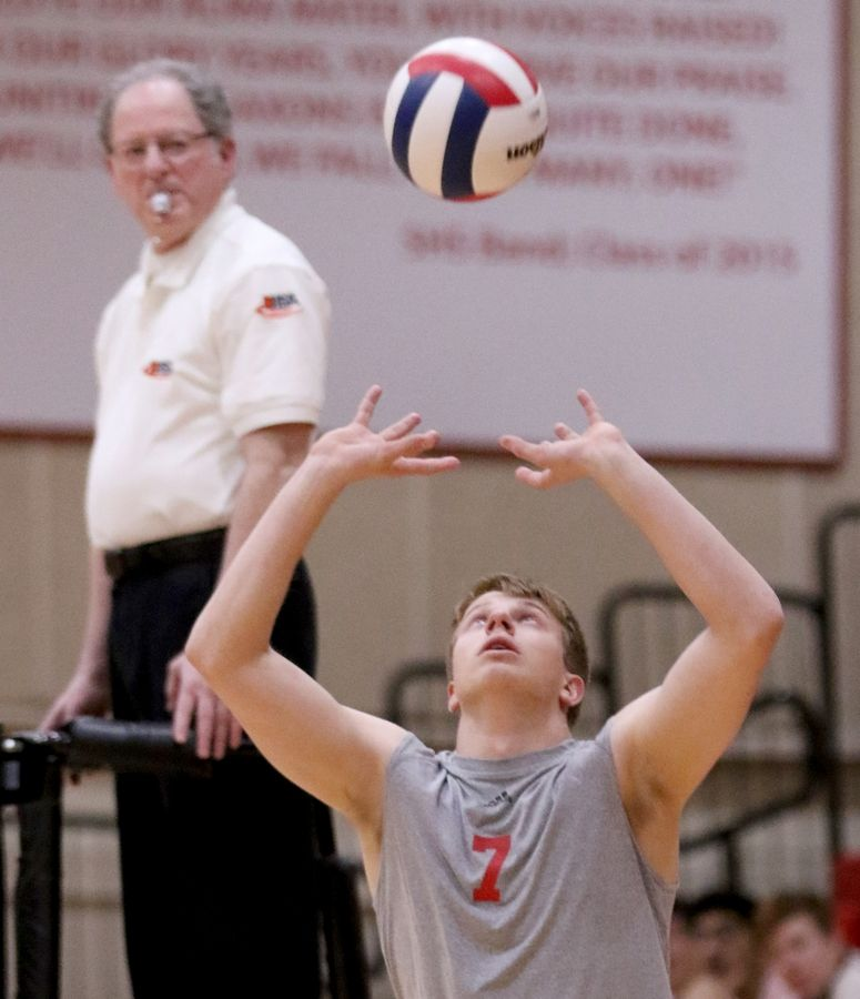 Barrington's Ben Ridgway prepares to set the ball during varsity boys volleyball in Schaumburg on Thursday.