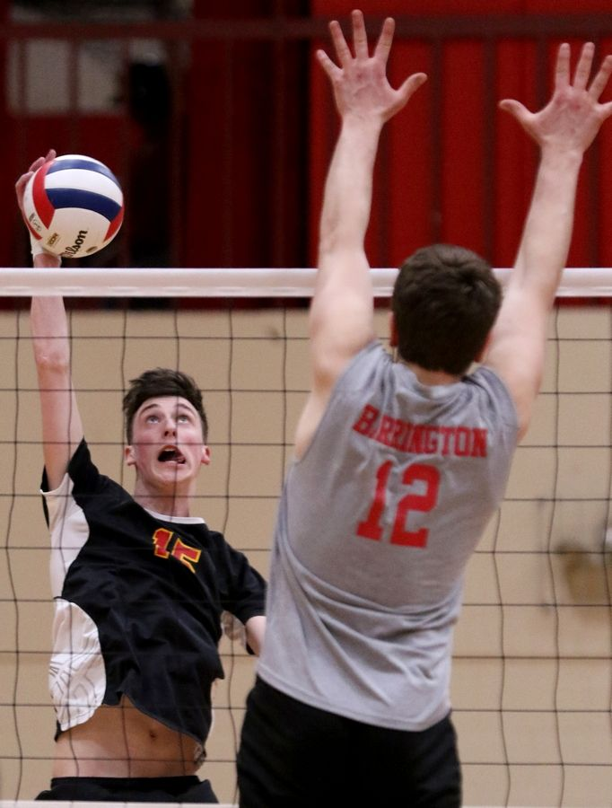 Schaumburg's Isaiah Mitchell hits the ball against Barrington during varsity boys volleyball in Schaumburg on Thursday.