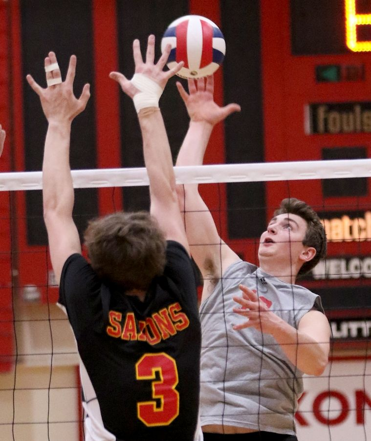Barrington's Gabe Hartke hits the ball during varsity boys volleyball in Schaumburg on Thursday.