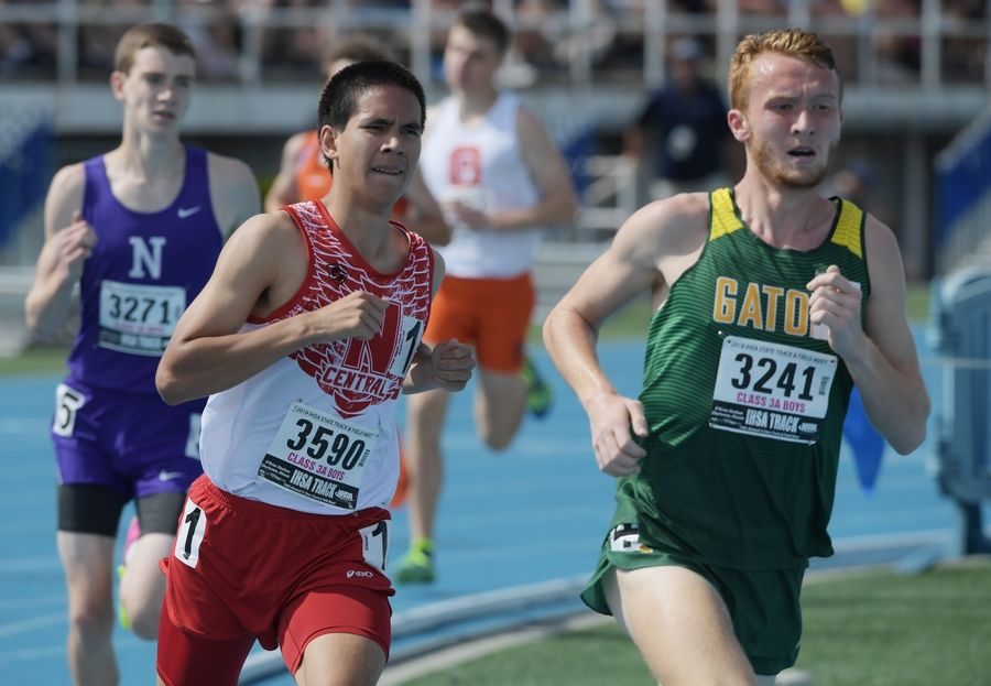 Joe Lewnard/jlewnard@dailyherald.comNaperville Central's Thomas Shilgalis, left, and Crystal Lake South's Jack Becker compete in the 1,600-meter run during the Class 3A boys state track and field finals in Charleston Saturday.