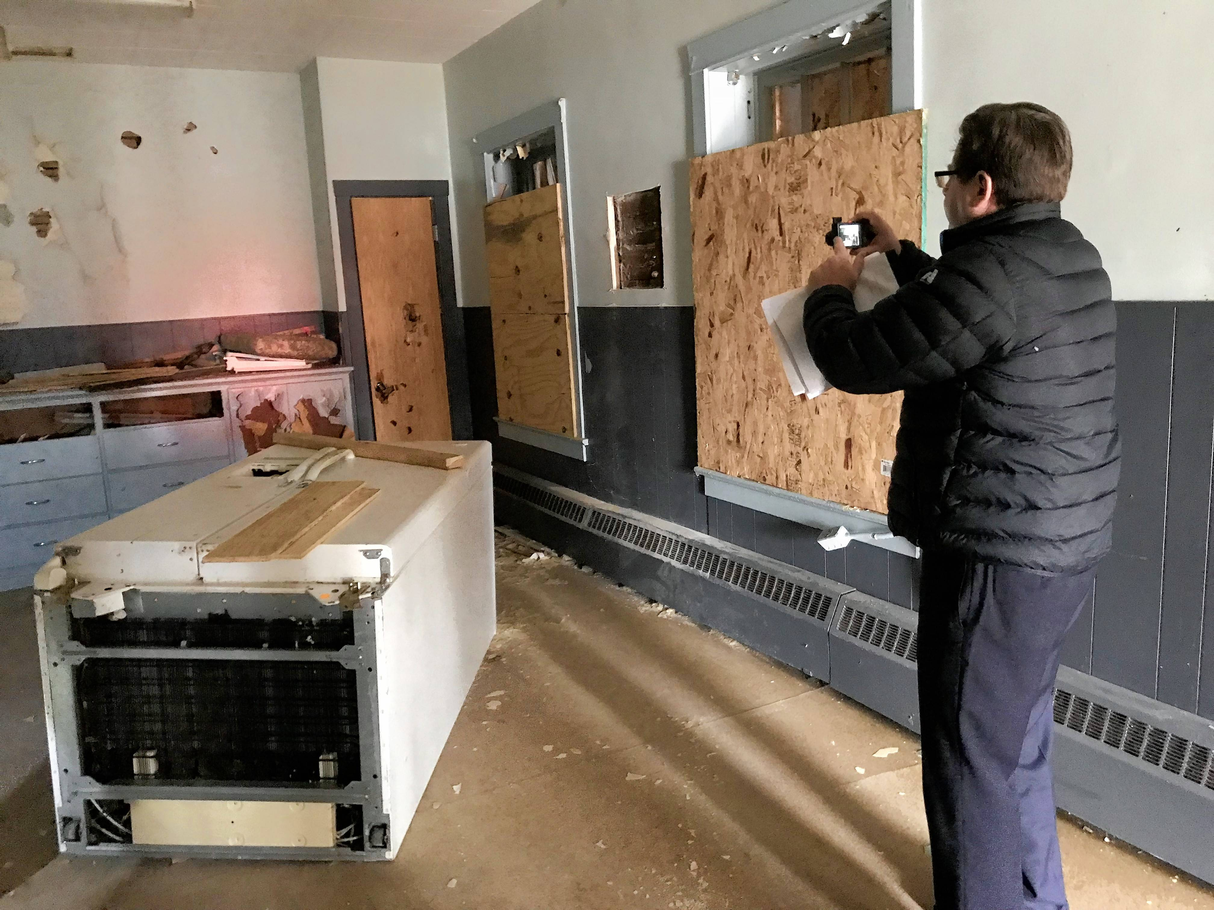 Michael Wingader of Integra Realty Resources took photos for an appraisal of the Larkin Center in Elgin during a tour of the 1912 building on Friday morning.