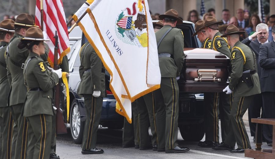 Honor Guard pallbearers place the casket of Illinois State Police trooper Gerald Ellis into the hearse during his funeral Friday at the College of Lake County in Grayslake.