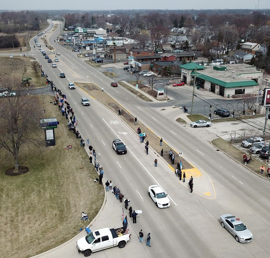 The funeral procession for Illinois State Police trooper Gerald Ellis leaves the College of Lake County in Grayslake, where services were held Friday.