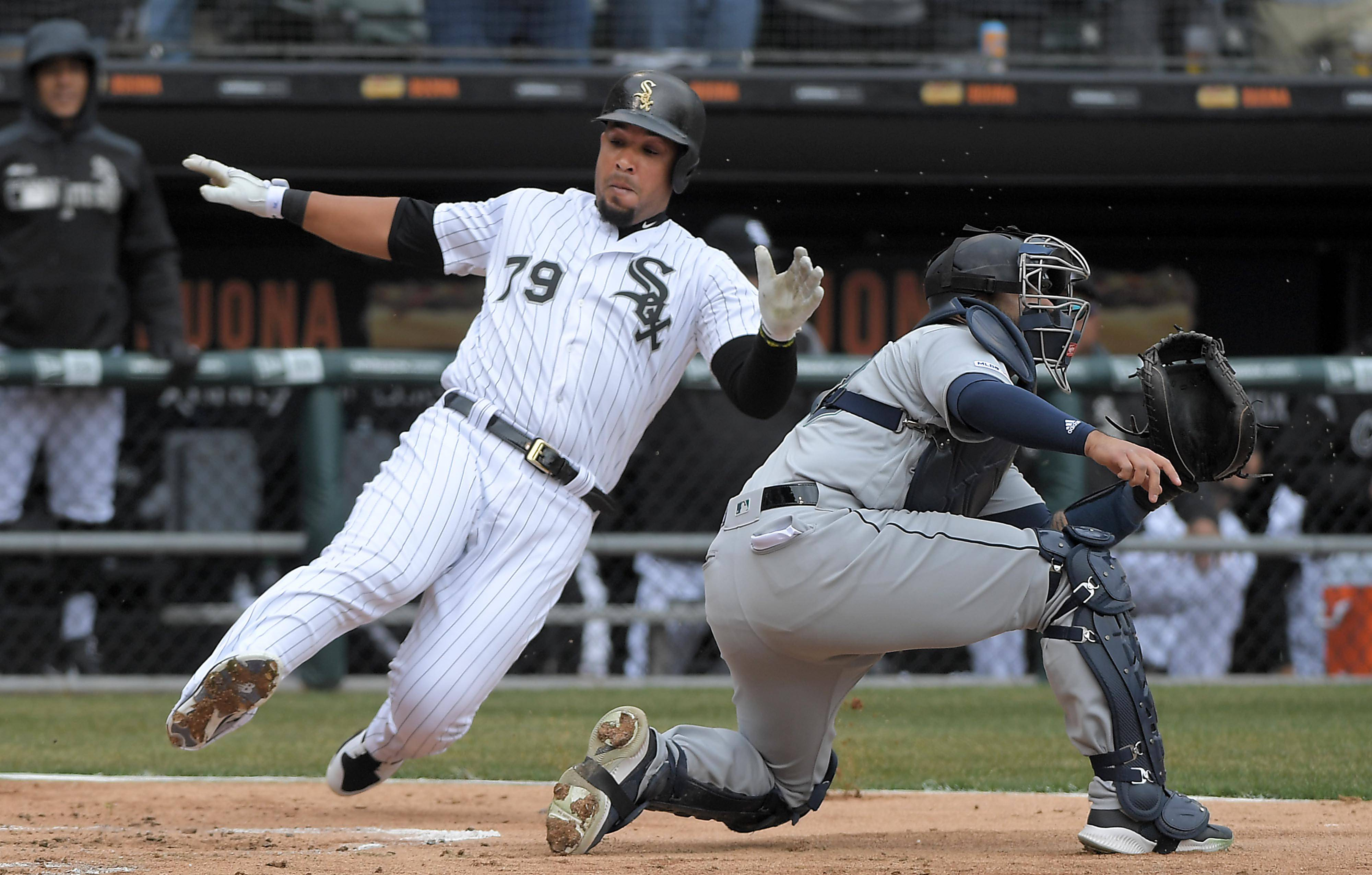 Chicago White Sox first baseman Jose Abreu scores on a double by teammate Yoan Moncada in the first inning at the home opener to the 2019 MLB season at Guaranteed Rate Field in Chicago Friday.