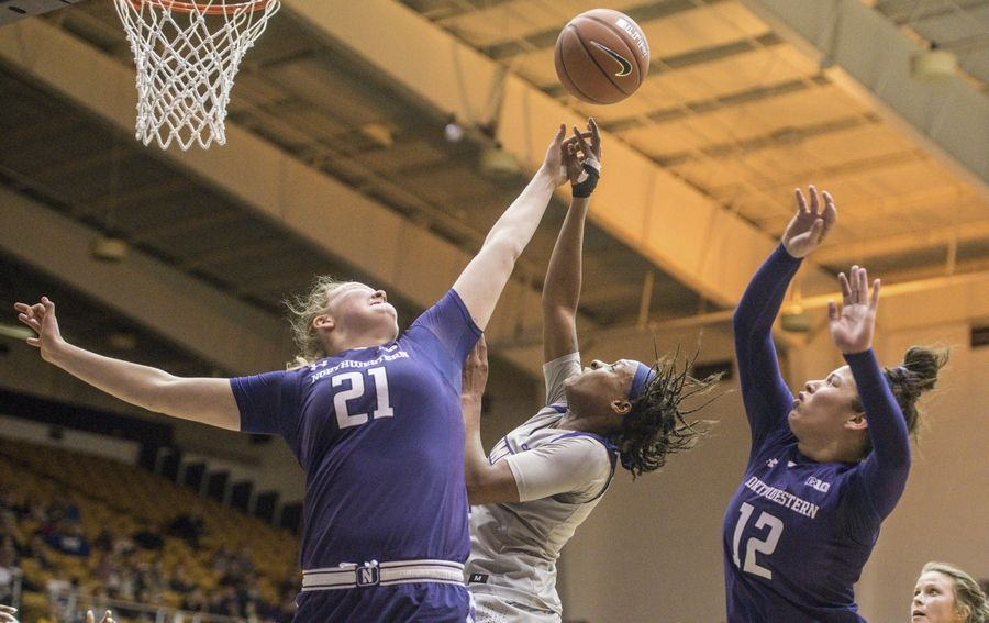 33a7b370a48662 James Madison guard Kamiah Smalls (3) loses control of the ball as she goes