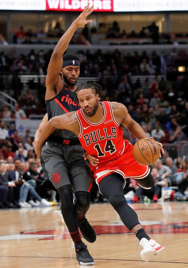 Chicago Bulls guard/forward Wayne Selden Jr., right, drives as Portland Trail Blazers forward Maurice Harkless defends during the first half of an NBA basketball game Wednesday, March 27, 2019, in Chicago.