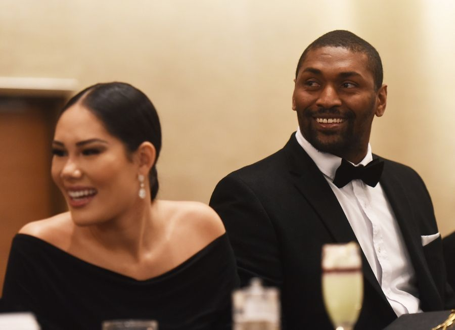 Metta World Peace sits beside his wife, Maya Sandiford-Artest, as he is honored with the Courage Award during the Illinois Commission on Diversity and Human Relations event commemorating the 51st anniversary of the death of Dr. Martin Luther King Jr. at the Renaissance Hotel in Schaumburg Saturday.