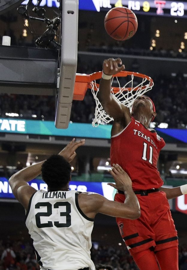 Texas Tech forward Tariq Owens (11) blocks a shot by Michigan State forward Xavier Tillman during the first half in the semifinals of the Final Four NCAA college basketball tournament, Saturday, April 6, 2019, in Minneapolis.
