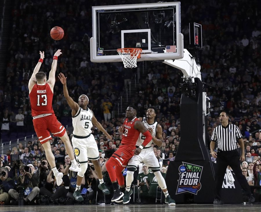 Texas Tech guard Matt Mooney shoots over Michigan State guard Cassius Winston during the Final Four Saturday in Minneapolis. Mooney matched his season-high 22 points in the win.