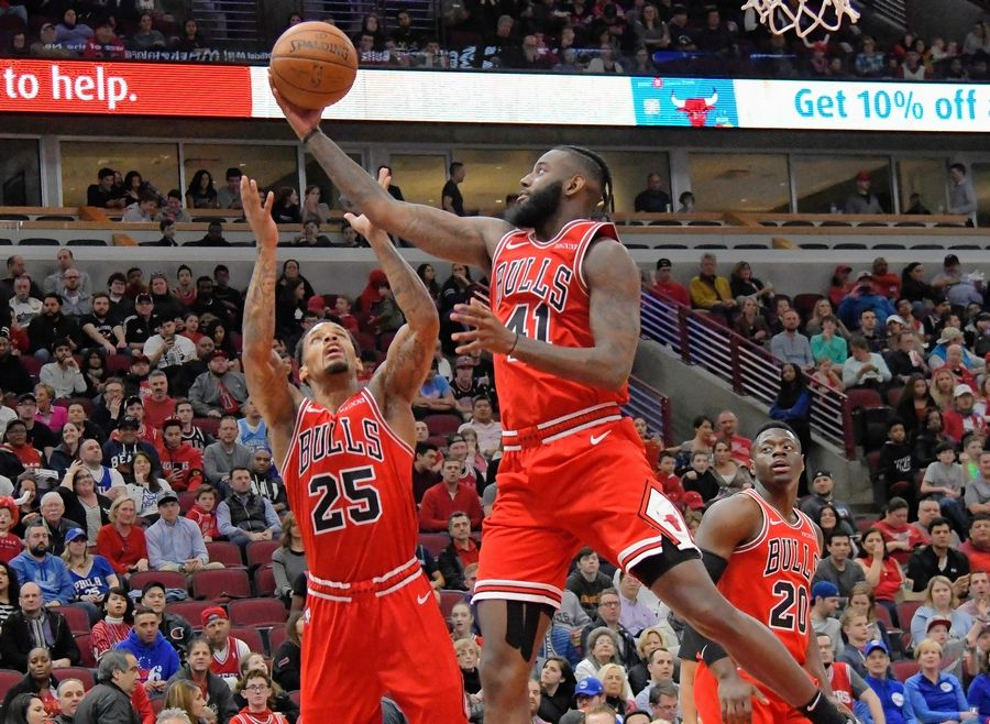 "Bulls forward JaKarr Sampson (41) and guard Walt Lemon Jr. (25) go up for a rebound against the Philadelphia 76ers on Saturday in Chicago. Sampson was with the Sixers during the ""Trust the Process"" years and said the Bulls can learn from that rebuild."