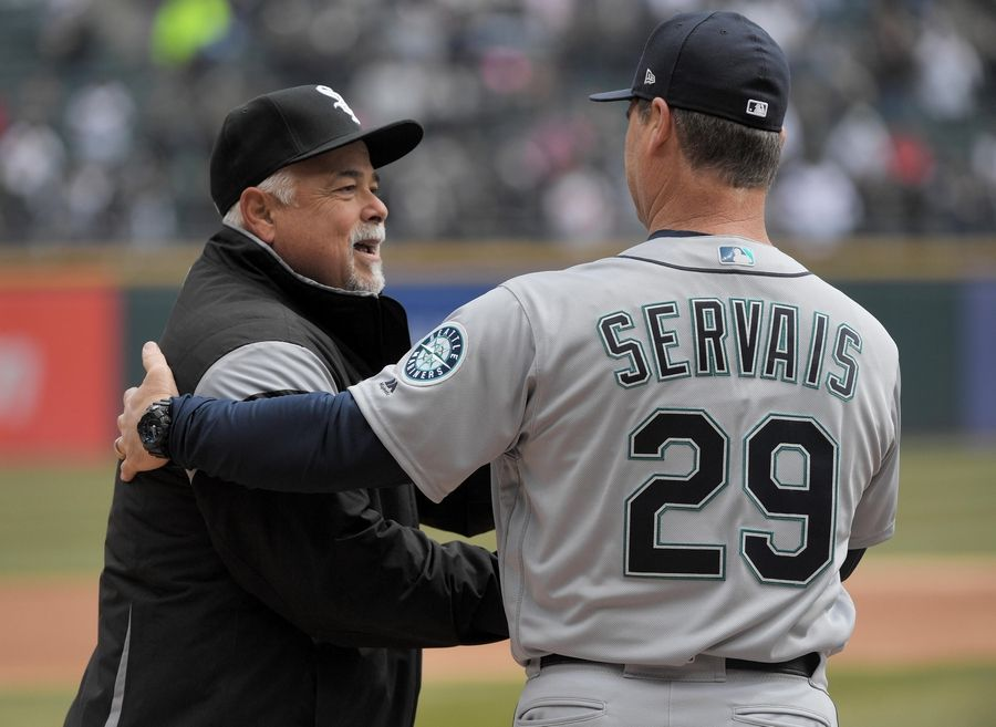 White Sox manager Rick Renteria greets Seattle Mariners manager Scott Servais at the home opener to the 2019 MLB season at Guaranteed Rate Field in Chicago on Friday.