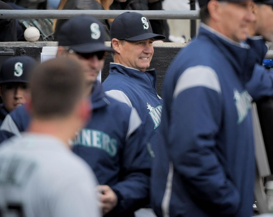 Seattle Mariners manager Scott Servais watches from the dugout at the White Sox home opener to the 2019 MLB season at Guaranteed Rate Field in Chicago on Friday.