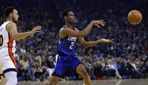 59ff1ef2359 Los Angeles Clippers  Shai Gilgeous-Alexander (2) passes the ball away from