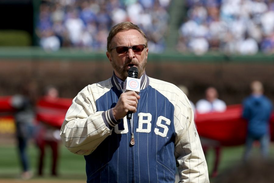 "Twenty-five years ago, Wayne Messmer was shot in the neck and fighting for his life. At Monday's Opening Day at Wrigley Field, Messmer ignores the ""gigantic, emotional lump"" in his throat, and performs another uplifting performance of the national anthem."