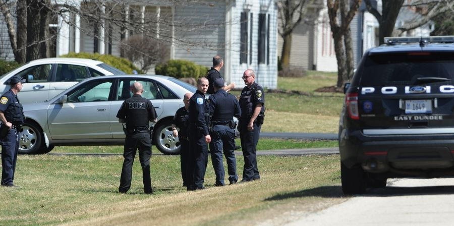Police gather Monday in Sleepy Hollow where two teens were stabbed in a home invasion. A suspect is in custody.