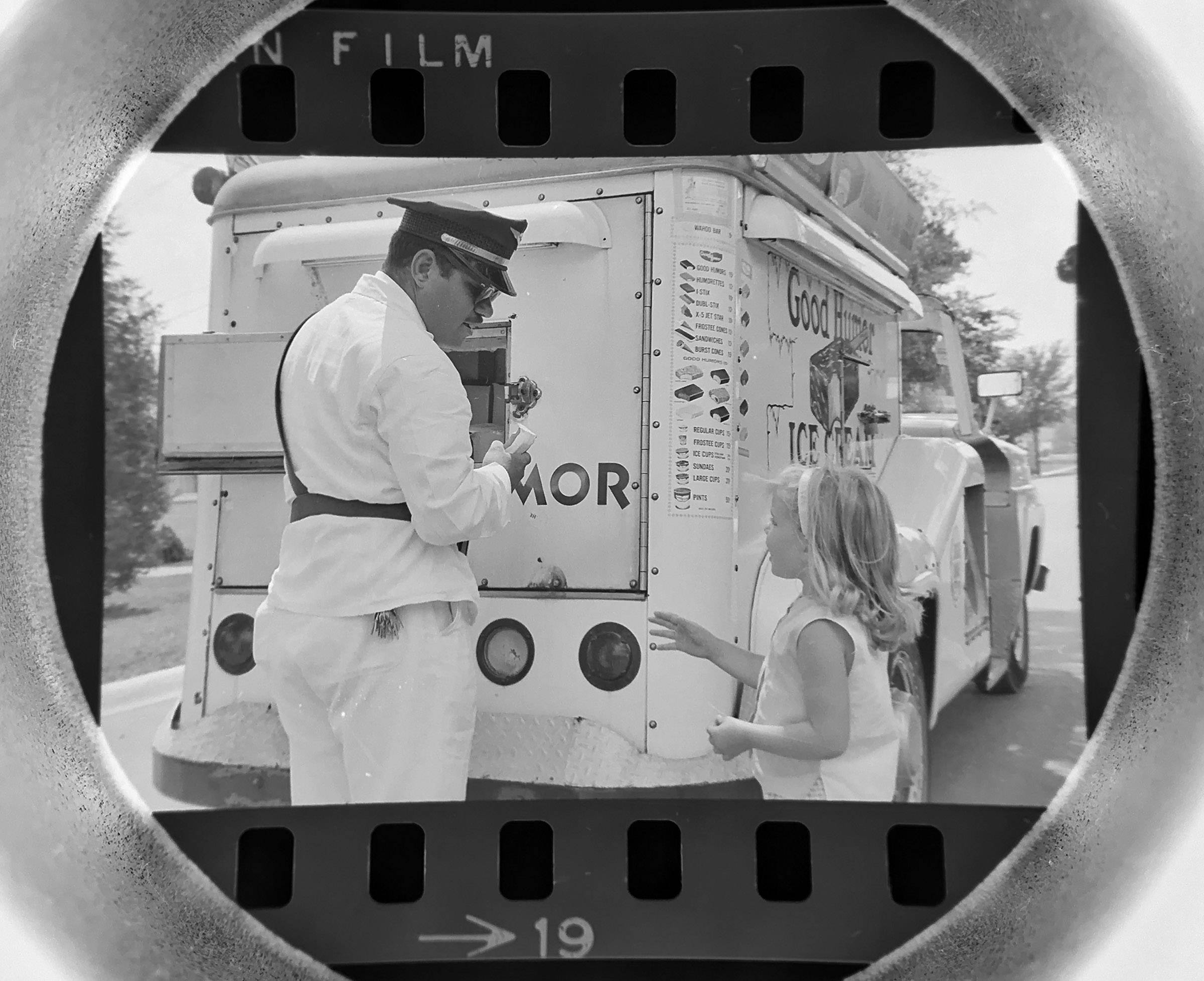 The Daily Herald Archive, Assignment # 1,531, Don Vickery photo: Good Humor man Carl Prell selling ice cream to a youngster in Arlington Heights in August of 1965