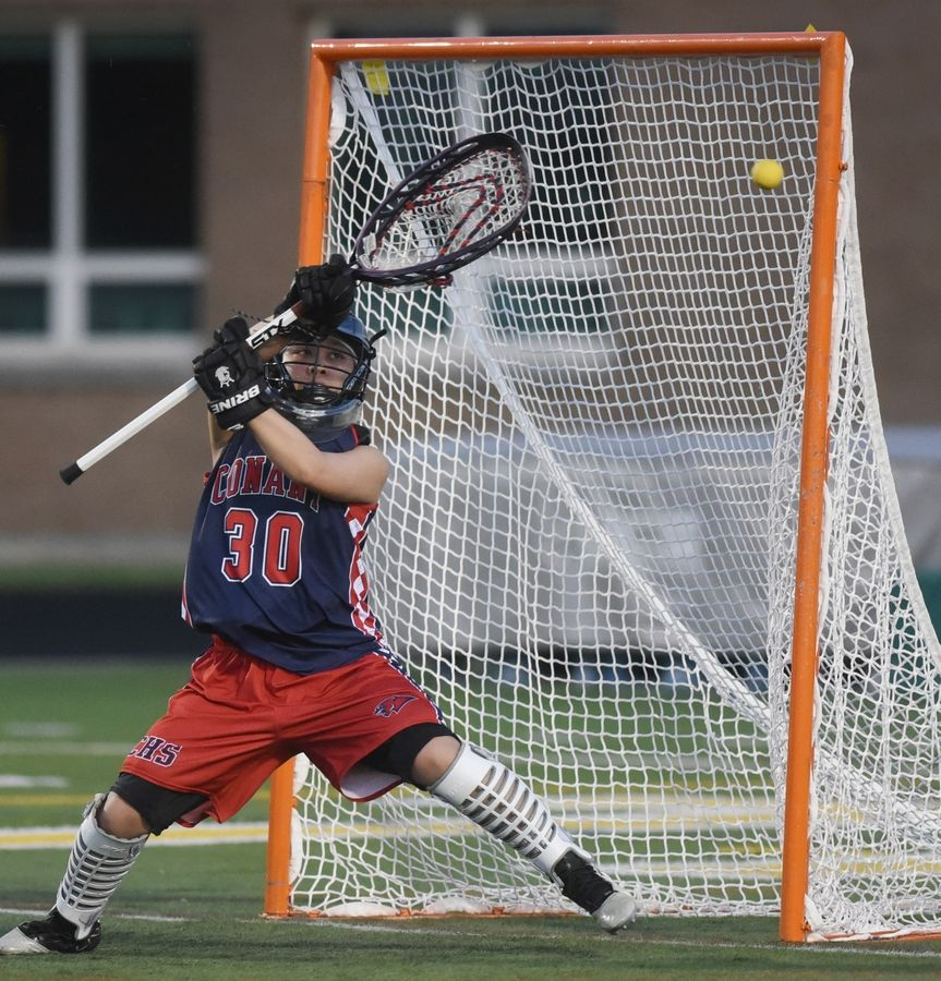 Conant goalkeeper Abby Alcantara keeps an eye on a wide throw to the net during Monday's girls lacrosse match against Stevenson in Lincolnshire.