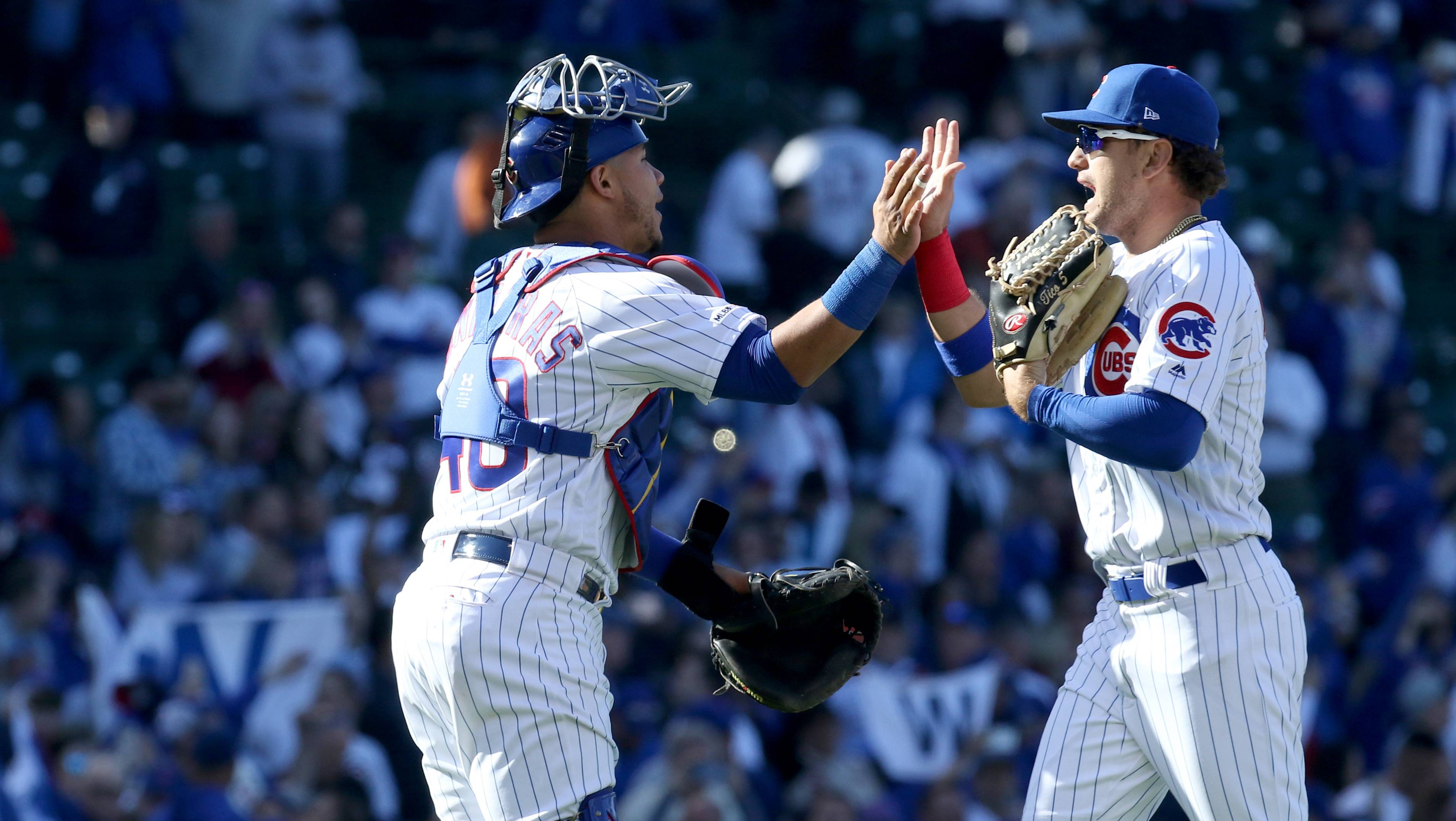 Chicago Cubs catcher Willson Contreras and Chicago Cubs center fielder Albert Almora Jr. congratulate one another after a win.