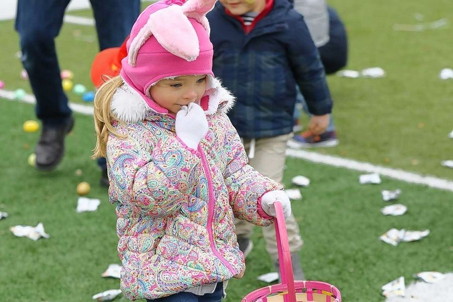 A little one samples her treasures at a previous Mooseheart egg hunt.