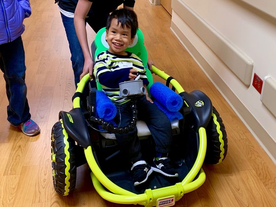 Daniel Cartwright of Algonquin rides in a car at Marianjoy Rehabilitation Hospital, part of Northwestern Medicine. It was an annual GoBabyGo workshop for 22 pediatric patients with disabilities and their families.