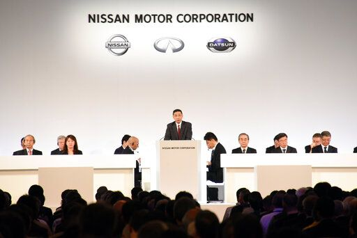In this photo released by Nissan Motor Co., Nissan Chief Executive Hiroto Saikawa, center, speaks at the company's shareholders' meeting in Tokyo Monday, April 8, 2019. Nissan shareholders approved on Monday the ouster from the Japanese automaker's board former Chairman Carlos Ghosn, who faces allegations of financial misconduct. (Nissan Motor Co. via AP)