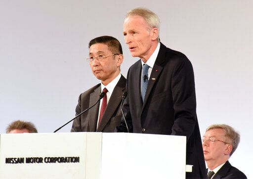 In this photo released by Nissan Motor Co., Renault Chairman Jean-Dominique Senard, center right, and Nissan Chief Executive Hiroto Saikawa, center left, attend the company's shareholders' meeting in Tokyo Monday, April 8, 2019. Nissan shareholders have approved the ouster of former chairman Carlos Ghosn from its board. The approval Monday was shown by applause from the shareholders gathered at a Tokyo hotel. Ahead of the vote, Nissan Chief Executive Saikawa apologized for the scandal at the Japanese automaker. Ghosn has been arrested on financial misconduct charges. Shareholders also okayed the appointment of Renault Chairman Senard to replace Ghosn. (Nissan Motor Co. via AP)