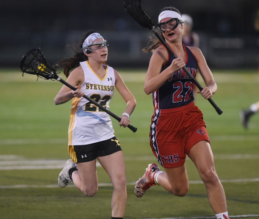 Stevenson's Shaina Zilber, left, looks to pass under pressure from Conant's Hannah Shulman during Monday's girls lacrosse match in Lincolnshire.
