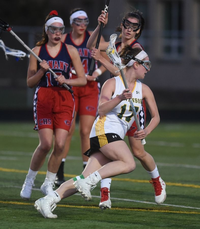 Stevenson's Erica Spieler (17) heads toward the goal under heavy Conant defense during Monday's girls lacrosse match in Lincolnshire.