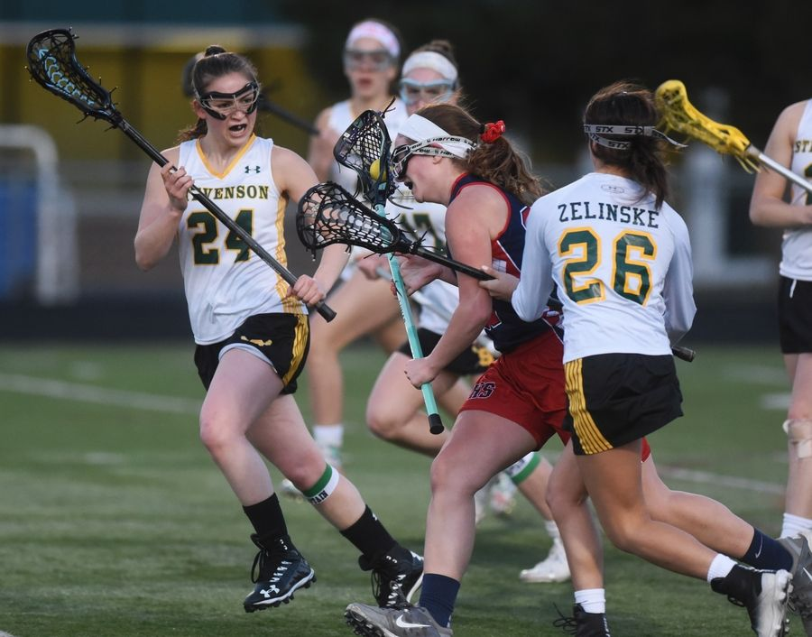 Stevenson's Georgia Maskalunas (24) and Skylar Zelinske (26) pressure Conant's Taylor Anderson during Monday's girls lacrosse match in Lincolnshire.