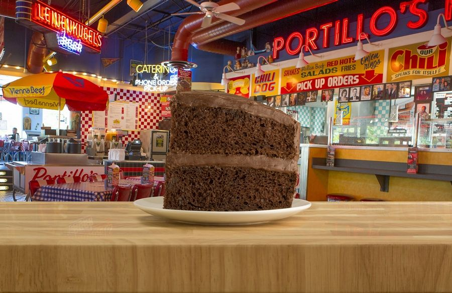 In honor of its 56th birthday, Portillo's is offering diners a slice of its famous chocolate cake for 56 cents with the purchase of an entree at all locations Tuesday, April 9.