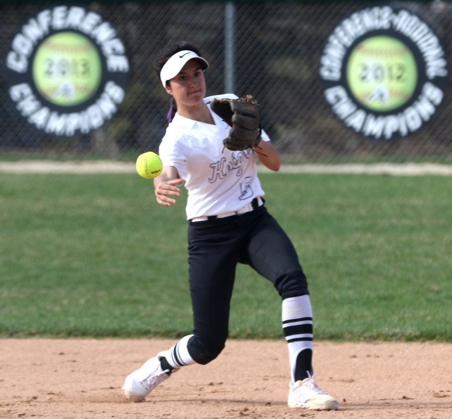Kaneland's Donatella Sommesi fires a throw to first base on an infield putout during girls varsity softball at Maple Park Tuesday.