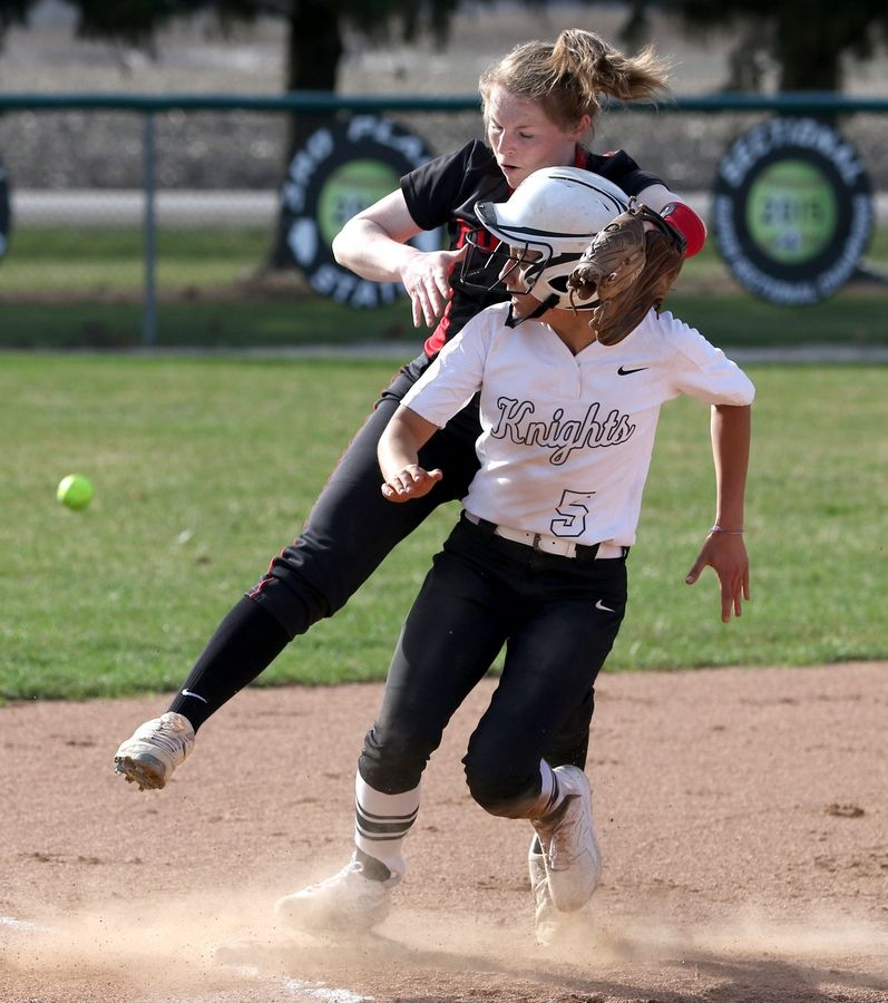 Yorkville's Teaghen Amwoza, back, tries to avoid landing on Kaneland baserunner Donatella Sommesi as the ball flies wide of third base during girls varsity softball at Maple Park Tuesday. Sommesi was safe on a steal of third base.