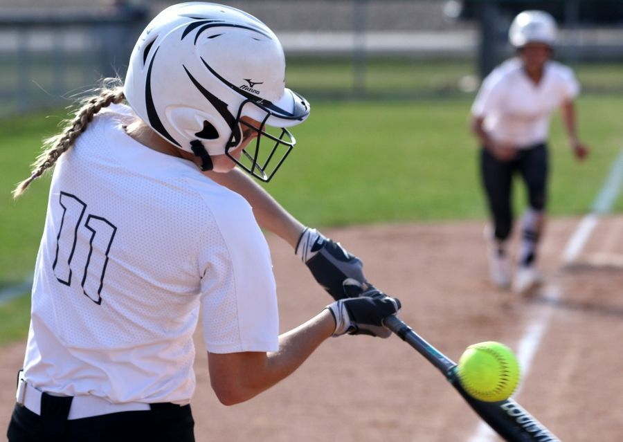 Kaneland's Olivia Ortegel fouls off a pitch during girls varsity softball at Maple Park Tuesday.