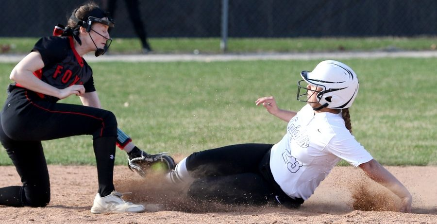 Yorkville's Haylee Reyes, left, applies the late tag as Kaneland's Lillie Lindgren pulls into second base with a double during girls varsity softball at Maple Park Tuesday.