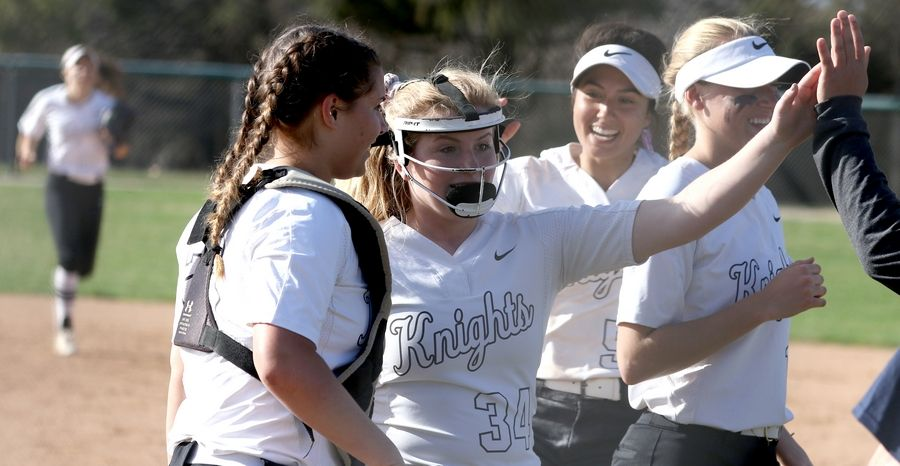 From left, Kaneland's Lillie Lindgren, Emilee Erickson and Donatella Sommesi are all smiles after an easy second inning against Yorkville in Maple Park Tuesday. Erickson tossed a 1-hit shutout in Kaneland's 1-0 victory.