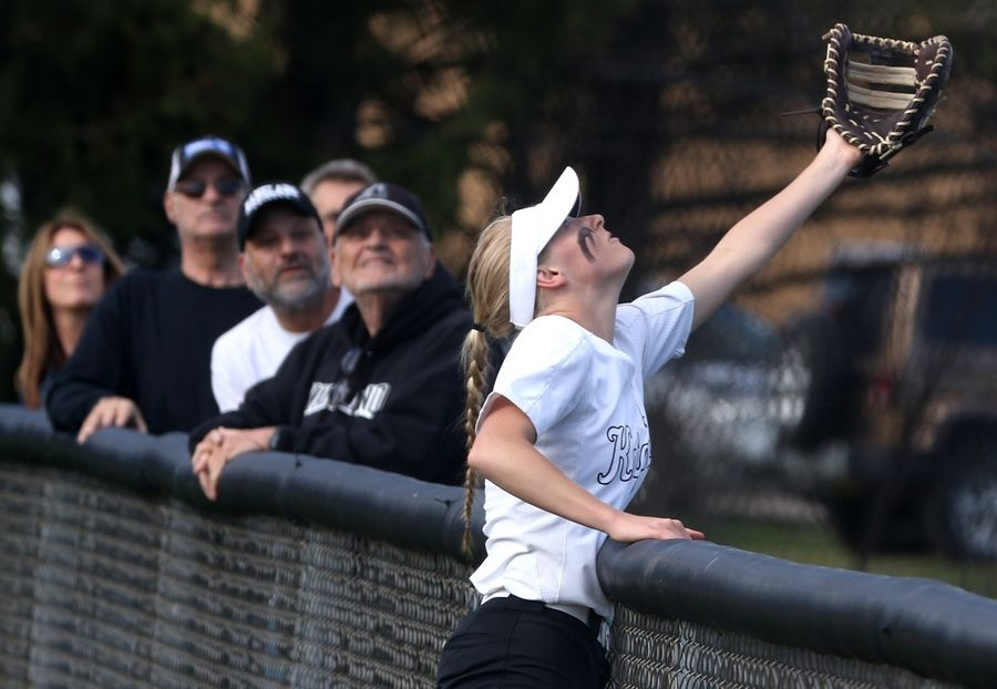 Kaneland first baseman Olivia Ortegel reaches for a foul ball during girls varsity softball at Maple Park Tuesday.