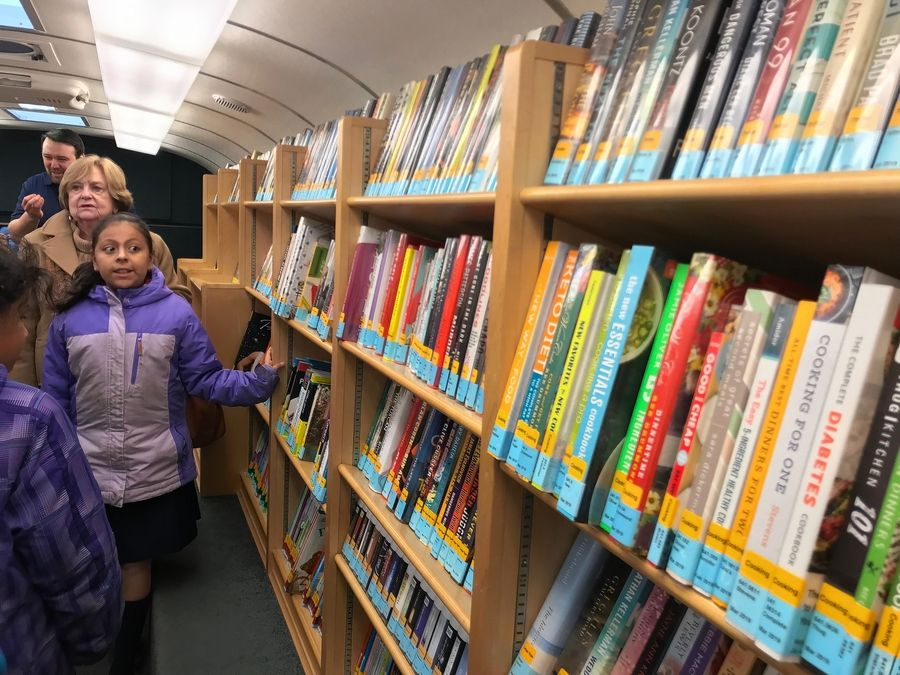 "The Gail Borden Public Library's bookmobile, purchased ""gently used"" from a library in Ohio, is stocked with about 2,500 books in English and Spanish, DVDs, large-type books and audiobooks."