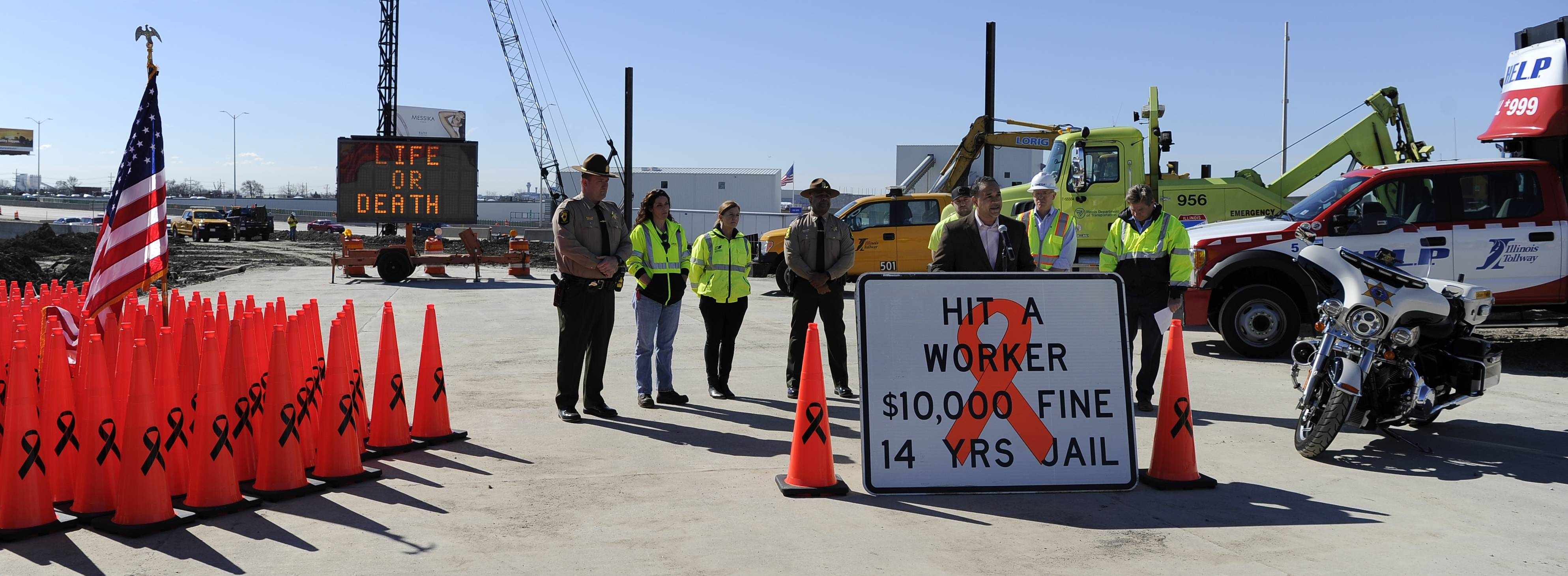 Illinois Department of Transportation and Illinois tollway employees urge drivers to watch out for workers as road construction ramps up this year. The traffic cones represent workers killed in crashes in work zones.