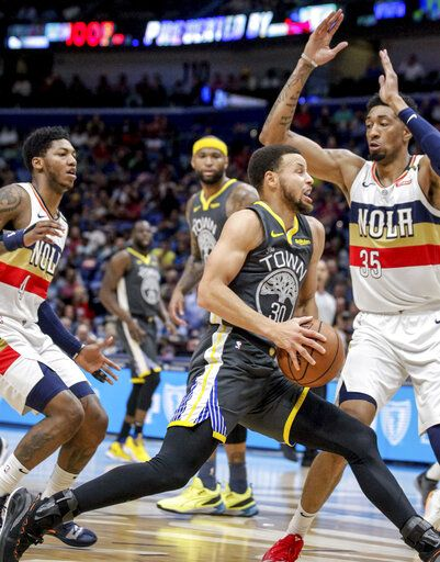 6021c004dfd Golden State Warriors guard Stephen Curry (30) drives against New Orleans  Pelicans forward Christian