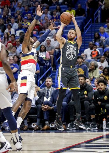 2aca88160c9 Golden State Warriors guard Stephen Curry (30) shoots over New Orleans  Pelicans guard Elfrid