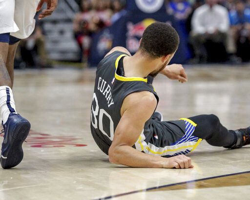 ee937e29a75 Golden State Warriors guard Stephen Curry (30) goes to the court after  twisting his