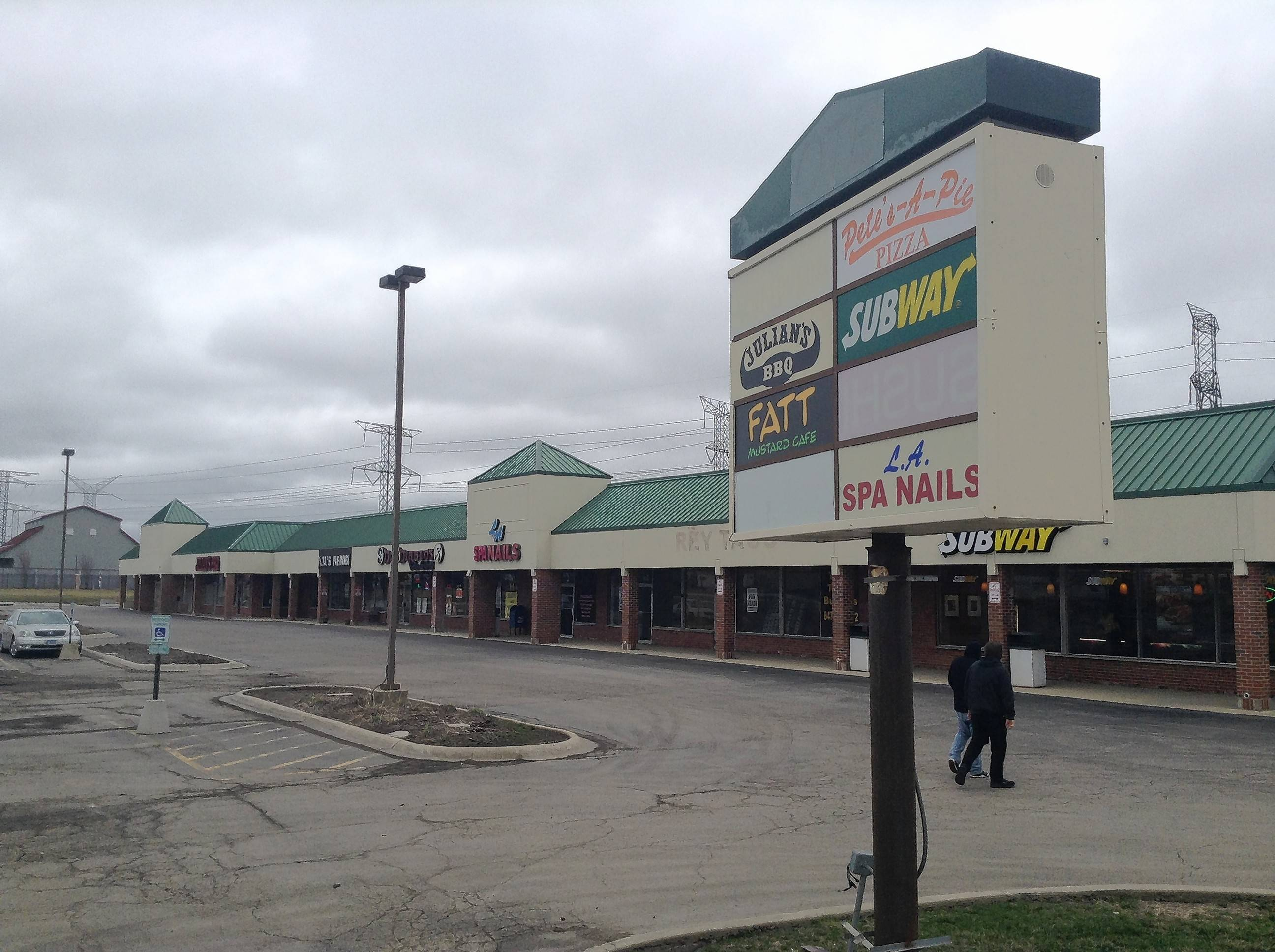 Most of a strip mall at Devon Avenue and Tonne Road in Elk Grove Village will be demolished to make way for a 146,000-square-foot warehouse. But officials say most of the existing restaurants in the shopping center will remain.