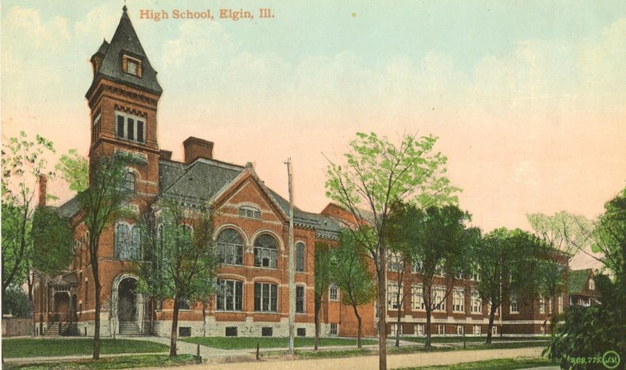 Demolition of the original Elgin High School building, on the left, was delayed in 1910 because students were continually throwing snowballs at the workers. Plans called for an expansion of the new wing on the right, now Elgin Area School District U-46's administration headquarters.