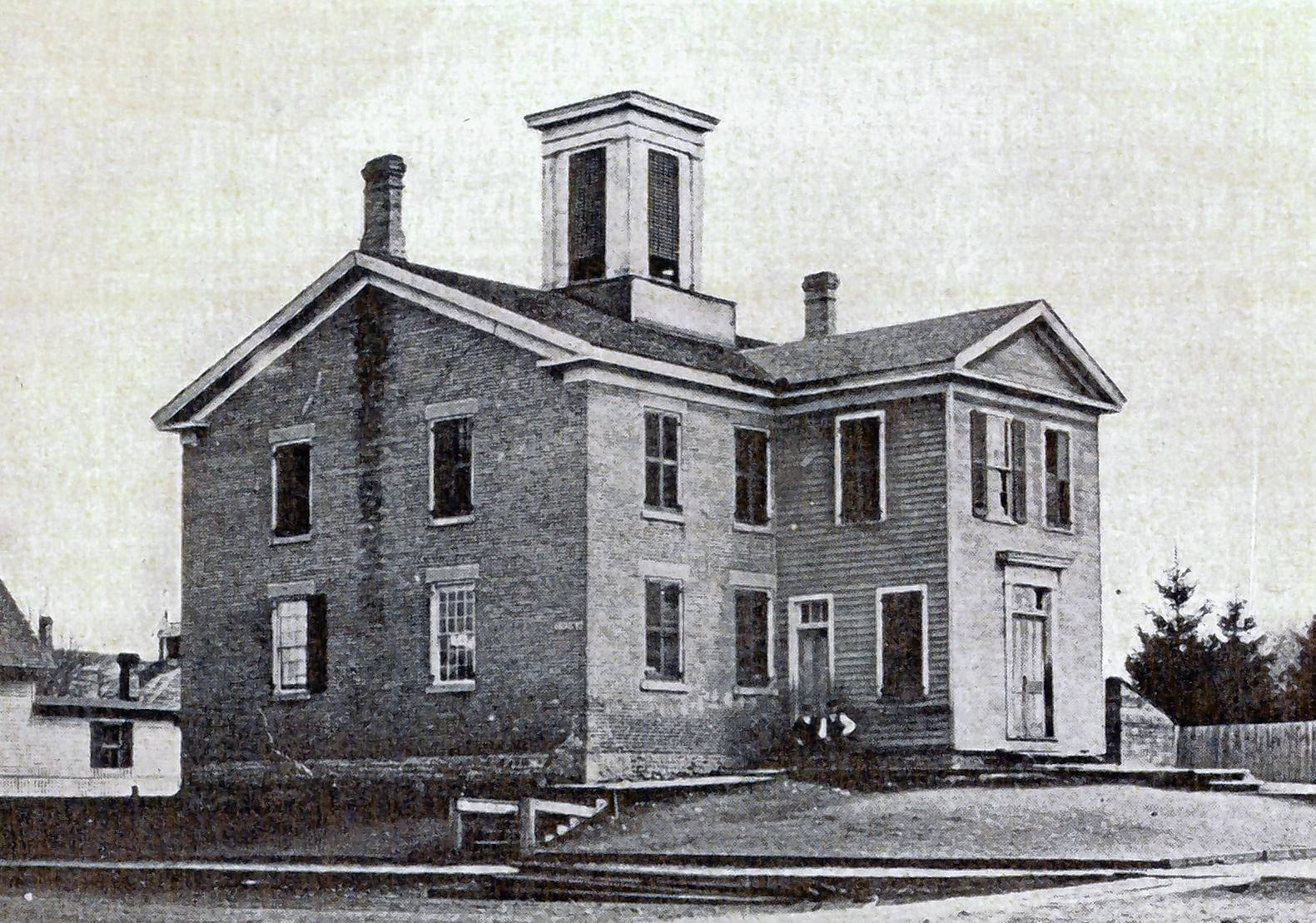 "The ""Old Brick"" building at Kimball and Center streets is where Elgin High School classes were held before the first school was built in 1884."