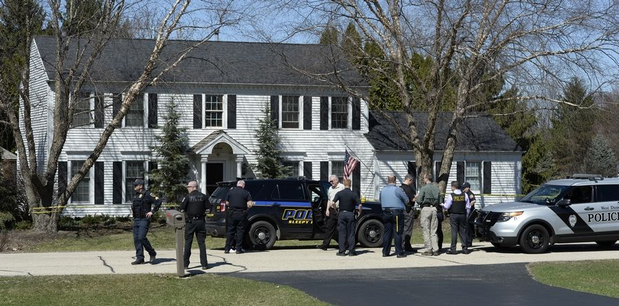 Police at the house in Sleepy Hollow where two teens were stabbed early Monday afternoon.