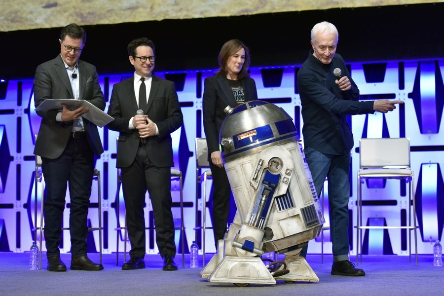 "Stephen Colbert, left, J.J. Abrams, Kathleen Kennedy, R2-D2 and Anthony Daniels participate in the ""Star Wars: The Rise of Skywalker"" panel on day one of the Star Wars Celebration at Wintrust Arena Friday in Chicago."