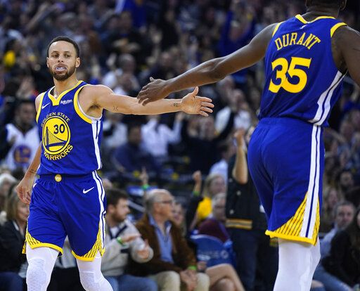 38506b74b Golden State Warriors  Kevin Durant (35) high-fives Stephen Curry (30