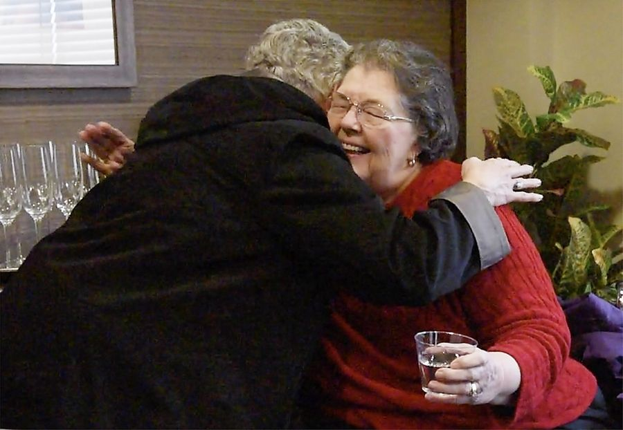 Mary Perucca, 85, hugs her sister Dorothy after she arrived in Grayslake recently. Mary's daughter Linda wrote an essay about he mother's wish to see her three sisters, whom she hadn't seen since 2015. Travanse Living, an assisted living facility in Grayslake, granted that wish.
